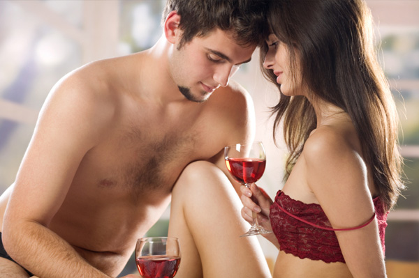 couple-having-wine-in-bed-on-valentines-day